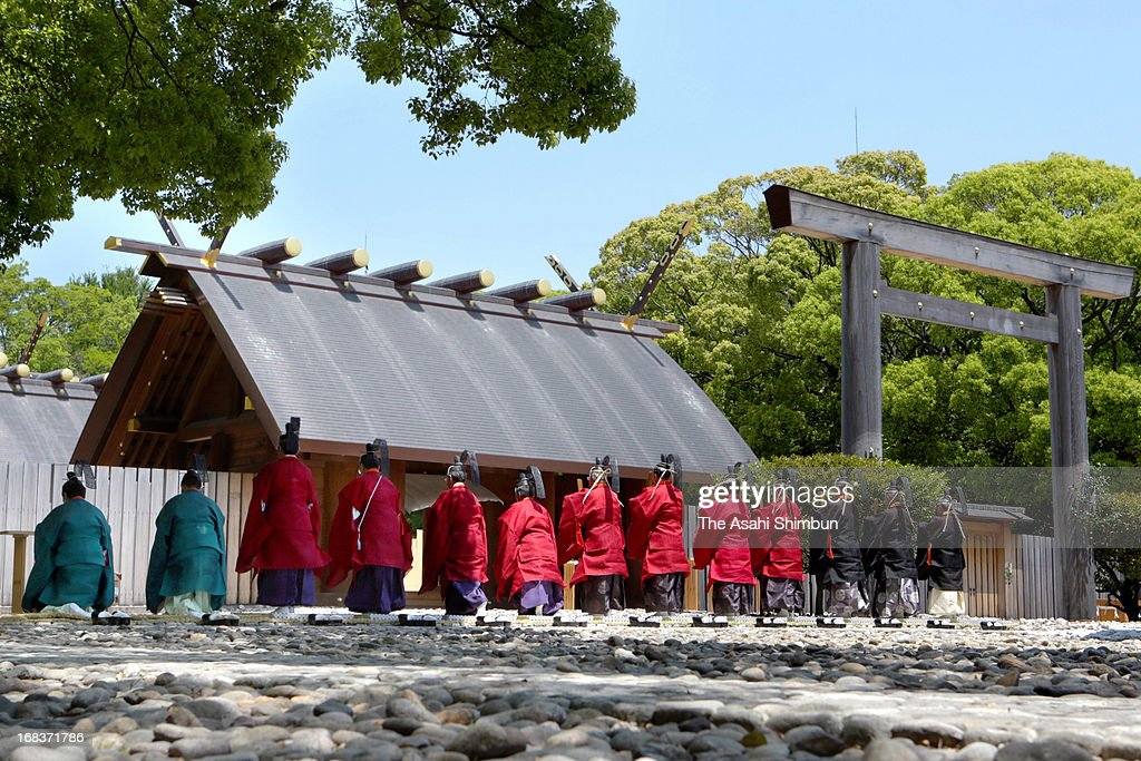 Shinto priests bow as Atsuta Jingu Shrine celebrating 1,900 years from its foundation on May 8, 2013 in Nagoya, Aichi, Japan. According to Japanese ancient chronicle 'Kojiki', thought to be written 711-712, the shrine was founded in 113, when a sword representing the Imperial succession was dedicated to the shrine for the first time.