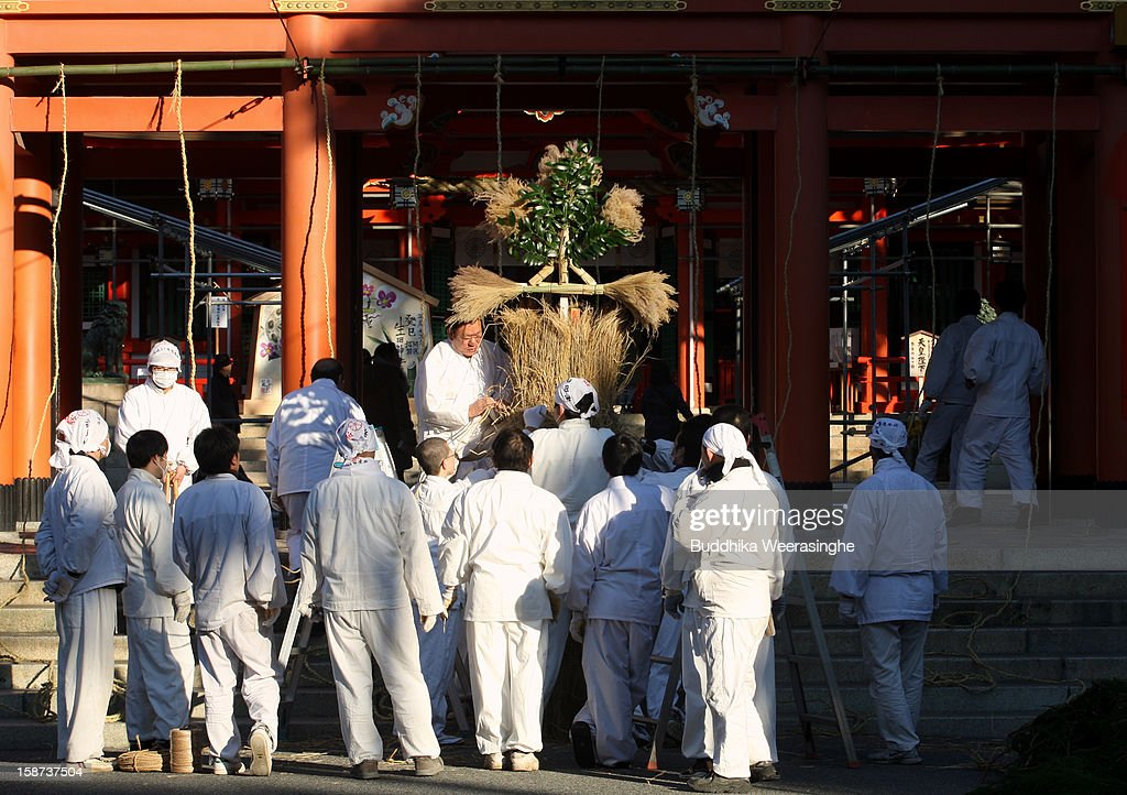 Shinto shrine priests decorate shrine entrance for forthcoming 'Year of the Snake' at Ikuta Shrine on December 27, 2012 in Kobe, Japan. Japanese years are commonly associated with the twelve animals Mouse, Cow, Tiger, Rabbit, Dragon, Snake, Horse, Sheep, Monkey, Rooster, Dog and Pig.