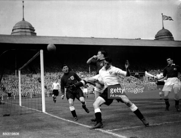 E Shinwell the Blackpool right back and Charlie Mitten of Manchester United tussle for the ball during a raid on the Blackpool goal in the opening...