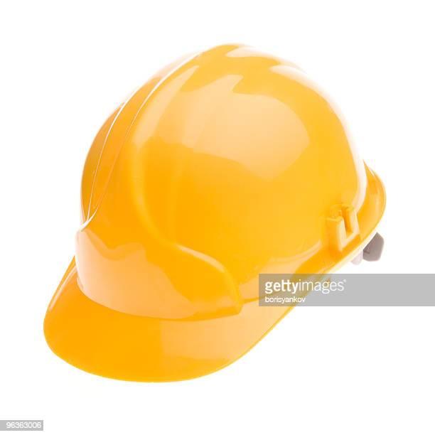 A shiny bright yellow hard hat
