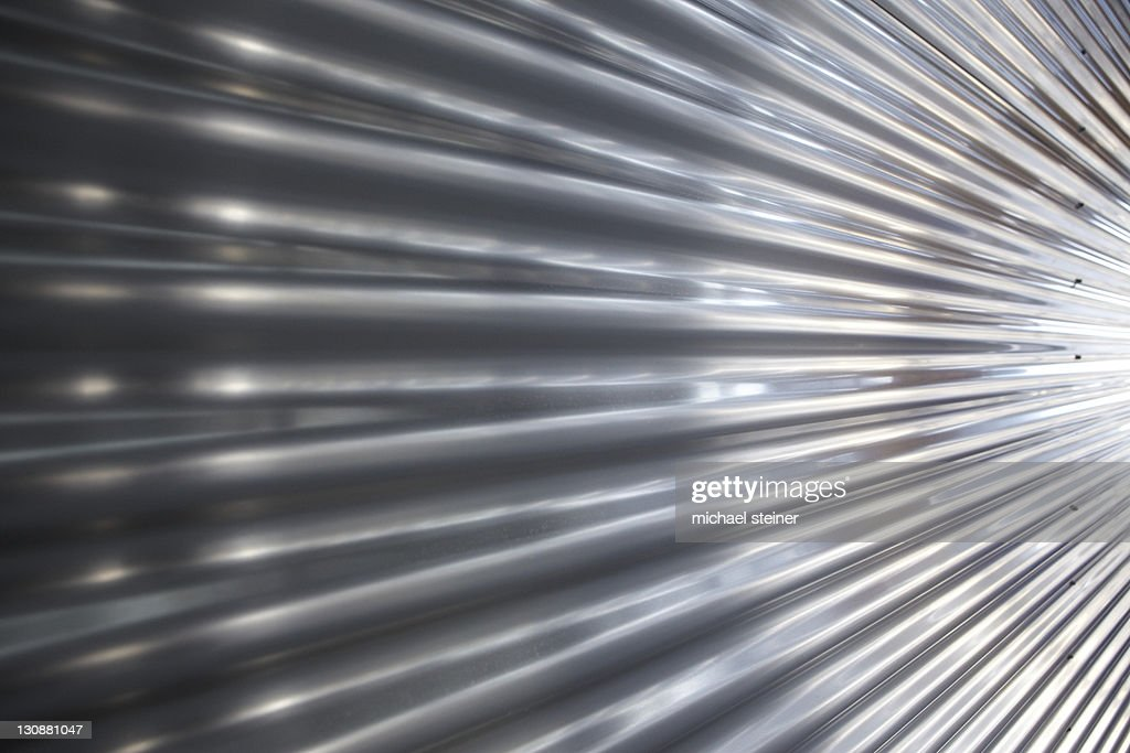 Shiny corrugated metal facade, perspective