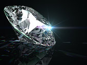 Brilliant diamond on black surface. Three-dimensional illustration.