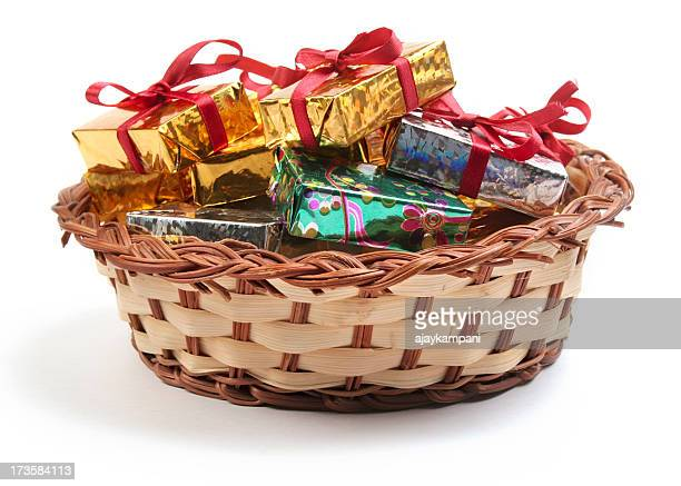 Shiny gift wrapped boxes in a weaved basket