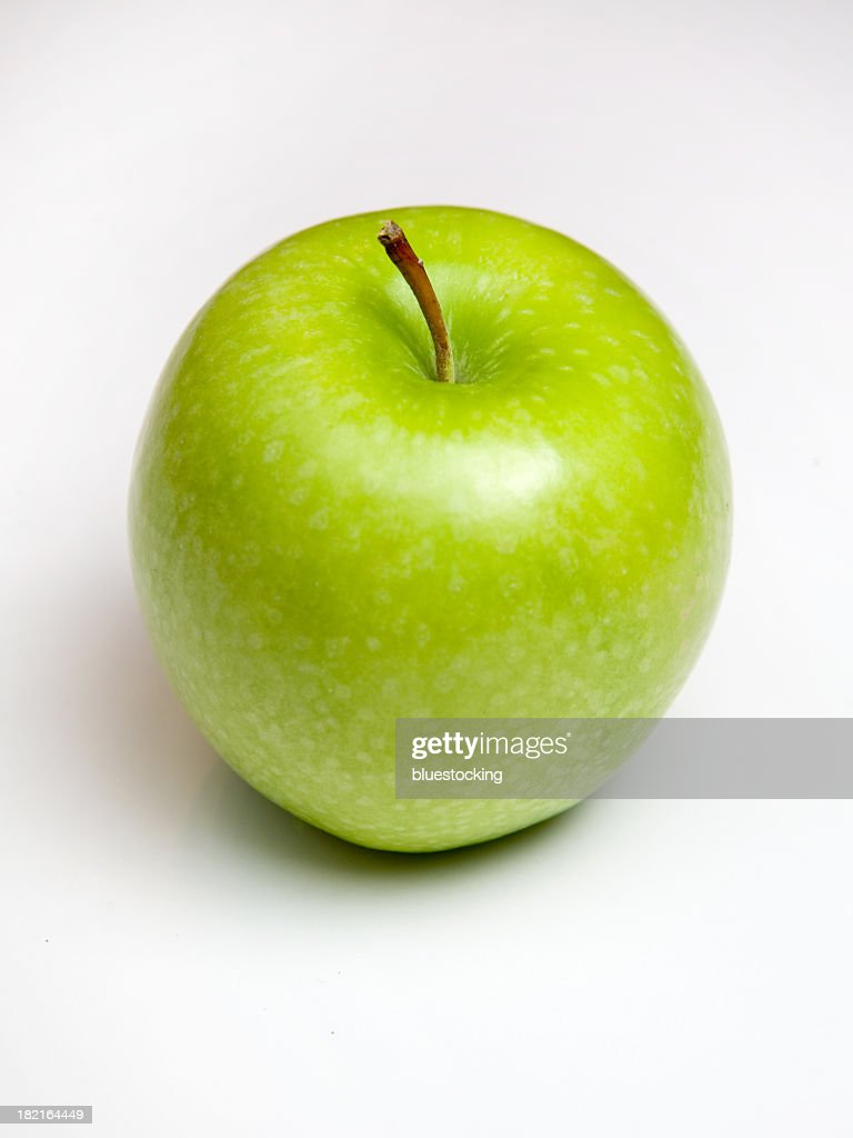 Shiny green apple with stalk isolated on white