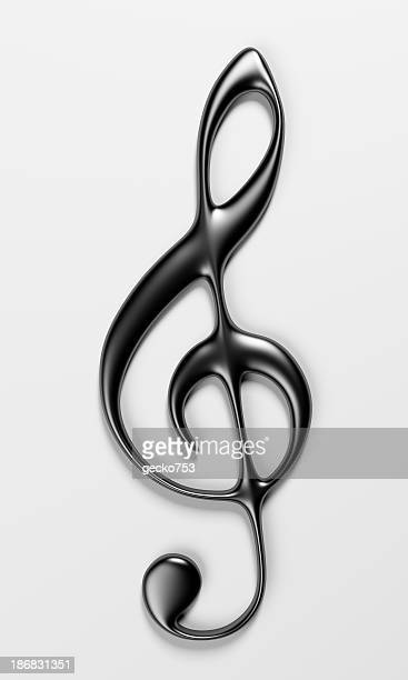 A shiny treble clef with shadow on a white background