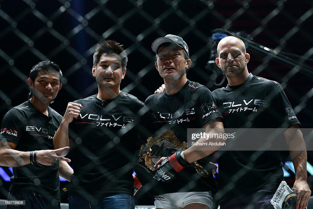 Shinya Aoki of Japan (2R) celebrates victory with his club teammates after his Lightweight World Championship bout win over Kotetsu Boku of Japan during the One Fighting Championship at Singapore Indoor Stadium on April 5, 2013 in Singapore.