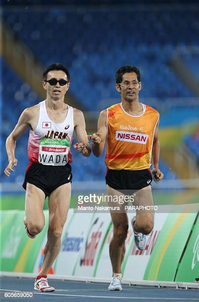 Shinya Wada Guide Takashi Nakata of Japan compete on day 13 of the 2016 Rio Paralympic Games at Olympic Stadium on September 13 2016 in Rio de...