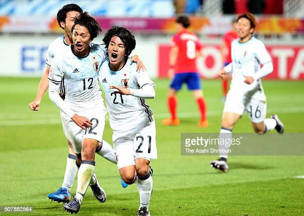 Shinya Yajima of Japan celebrates scoring his team's second goal with his team mate Sei Muroya during the AFC U23 Championship final match between...