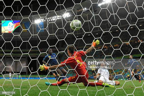 Shinya Yajima of Japan scores his team's first goal past Andreas Linde of Sweden during the Men's Football Group B match between Japan and Sweden at...