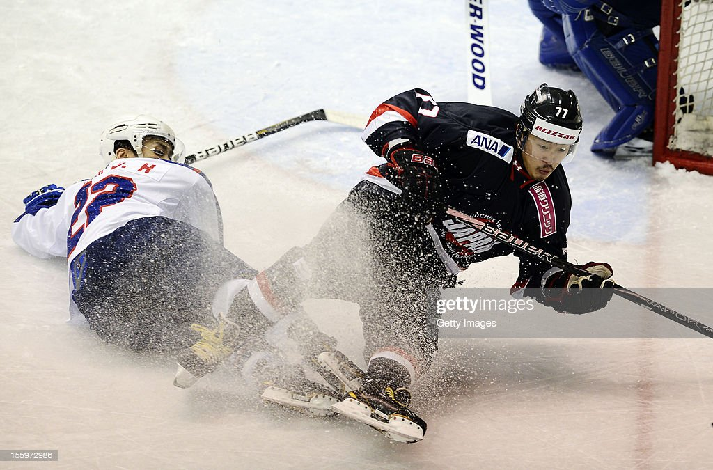 Shinya Yanadori #77 of Japan skates against Kim Donghwan #22 during the Ice Hockey Sochi Olympic Pre-Qualification Group J match between Japan and South Korea at Nikko Kirifuri Ice Arena on November 10, 2012 in Nikko, Tochigi, Japan. Japan won after over time 3-2.