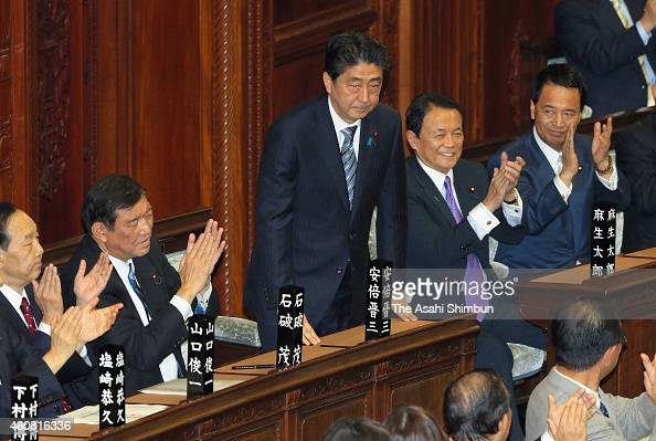 Shinzo Abe acknowledges Lower House members after being reelected as Japanese Prime Minister at the lower house plenary session of the Diet on...