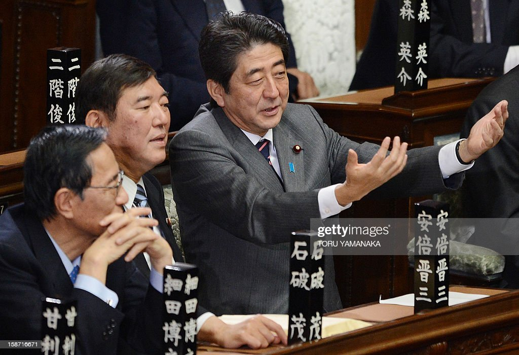 Shinzo Abe (R) chats with Secretary General of the Liberal Democratic Party (LDP) Shigeru Ishiba (2nd L) and former Chief Cabinet Secretary Hiroyuki Hosoda (L) before voting to elect a new prime minister at the lower house of parliament in Tokyo on December 26, 2012. The powerful lower house named the 58-year-old Abe as the country's new leader following a resounding national election victory for Abe's LDP earlier this month over the booted Democratic Party of Japan (DPJ). AFP PHOTO/Toru YAMANAKA