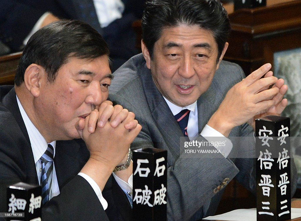 Shinzo Abe (R) chats with Secretary General of the Liberal Democratic Party (LDP) Shigeru Ishiba (L) before voting to elect a new prime minister at the lower house of parliament in Tokyo on December 26, 2012. The powerful lower house named the 58-year-old Abe as the country's new leader following a resounding national election victory for Abe's LDP earlier this month over the booted Democratic Party of Japan (DPJ). AFP PHOTO/Toru YAMANAKA