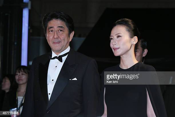 Shinzo Abe Japanese Prime Minister and actress Miki Nakatani arrive at the opening ceremony during the 27th Tokyo International Film Festival at...