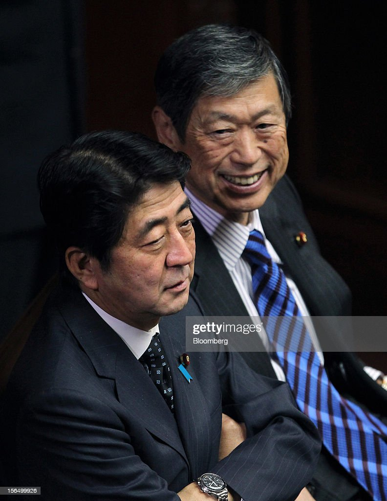<a gi-track='captionPersonalityLinkClicked' href=/galleries/search?phrase=Shinzo+Abe&family=editorial&specificpeople=559017 ng-click='$event.stopPropagation()'>Shinzo Abe</a>, Japan's former prime minister and president of the Liberal Democratic Party (LDP), left, attends a plenary session at the Lower House of Parliament in Tokyo, Japan, on Friday, Nov. 16, 2012. Prime Minister Yoshihiko Noda dissolved the lower house of parliament today after the upper house passed a bill to issue bonds to finance spending for the rest of this fiscal year, following a months-long impasse that left the government weeks away from running out of money. The election will be held on Dec. 16. Photographer: Junko Kimura/Bloomberg via Getty Images