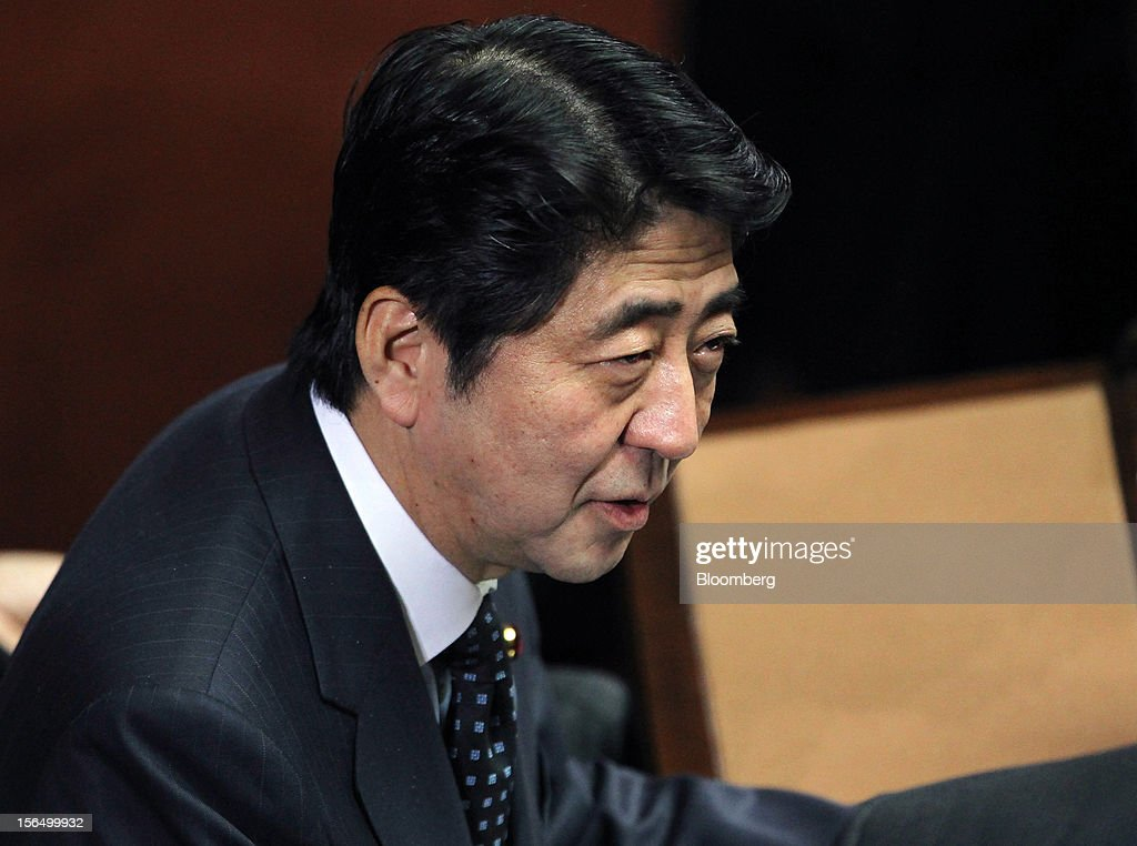 <a gi-track='captionPersonalityLinkClicked' href=/galleries/search?phrase=Shinzo+Abe&family=editorial&specificpeople=559017 ng-click='$event.stopPropagation()'>Shinzo Abe</a>, Japan's former prime minister and president of the Liberal Democratic Party (LDP), attends a plenary session at the Lower House of Parliament in Tokyo, Japan, on Friday, Nov. 16, 2012. Prime Minister Yoshihiko Noda dissolved the lower house of parliament today after the upper house passed a bill to issue bonds to finance spending for the rest of this fiscal year, following a months-long impasse that left the government weeks away from running out of money. The election will be held on Dec. 16. Photographer: Junko Kimura/Bloomberg via Getty Images