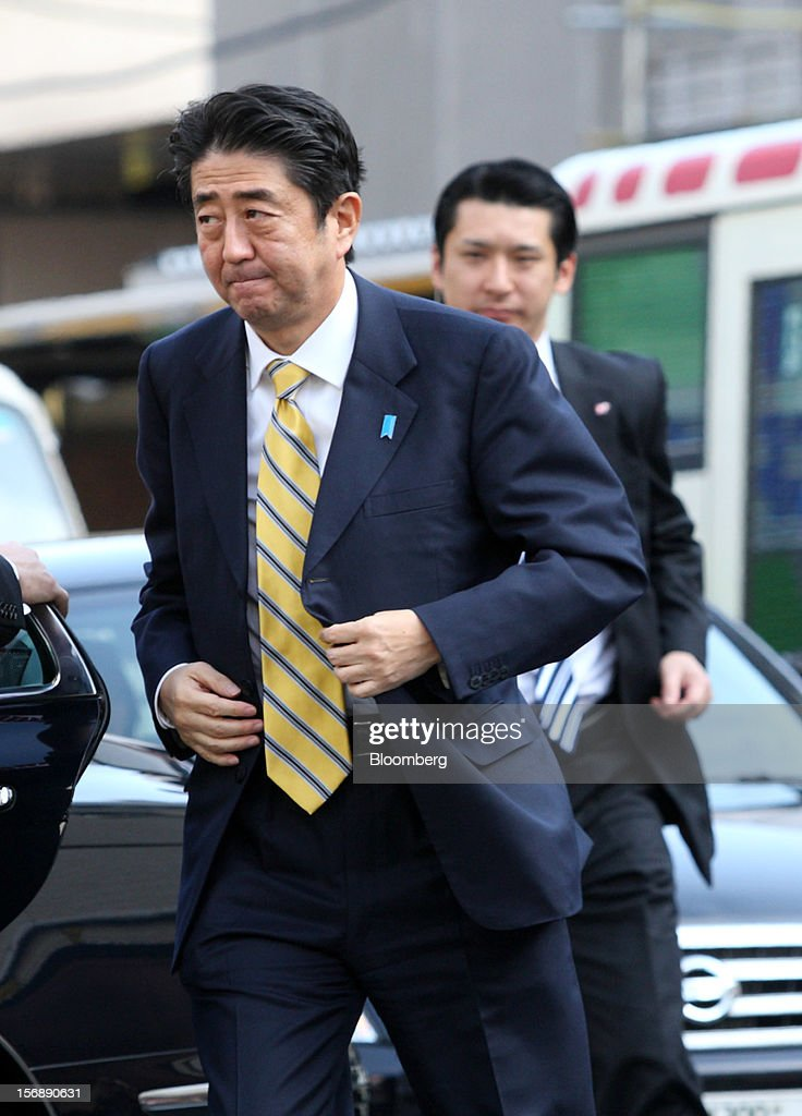 Shinzo Abe, Japan's former prime minister and president of the Liberal Democratic Party (LDP), left, arrives for a campaign rally for the Dec. 16 general election in Tokyo, Japan, on Saturday, Nov. 24, 2012. The government taking office after Japan's Dec. 16 election will pick the central bank's top three jobs, a chance to reshape policy in the third-largest economy that the opposition aims to seize for unlimited stimulus. Photographer: Tomohiro Ohsumi/Bloomberg via Getty Images