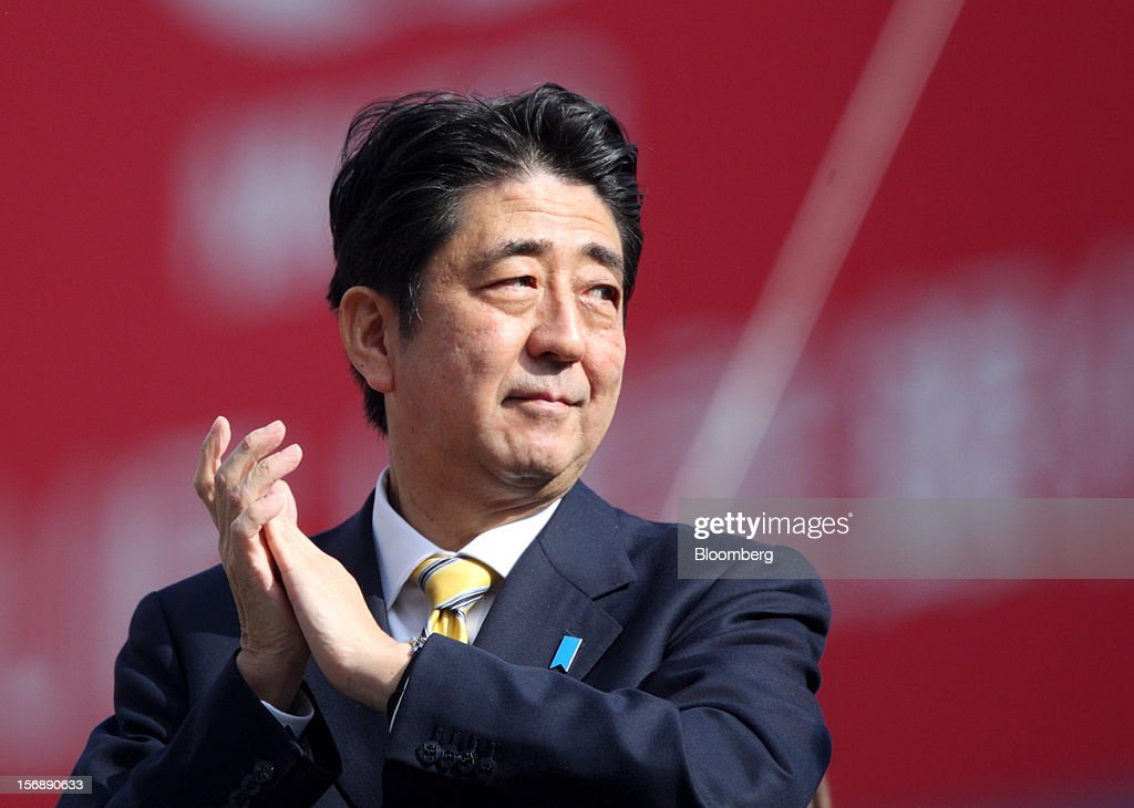 <a gi-track='captionPersonalityLinkClicked' href=/galleries/search?phrase=Shinzo+Abe&family=editorial&specificpeople=559017 ng-click='$event.stopPropagation()'>Shinzo Abe</a>, Japan's former prime minister and president of the Liberal Democratic Party (LDP), claps during a campaign rally for the Dec. 16 general election in Tokyo, Japan, on Saturday, Nov. 24, 2012. The government taking office after Japan's Dec. 16 election will pick the central bank's top three jobs, a chance to reshape policy in the third-largest economy that the opposition aims to seize for unlimited stimulus. Photographer: Tomohiro Ohsumi/Bloomberg via Getty Images