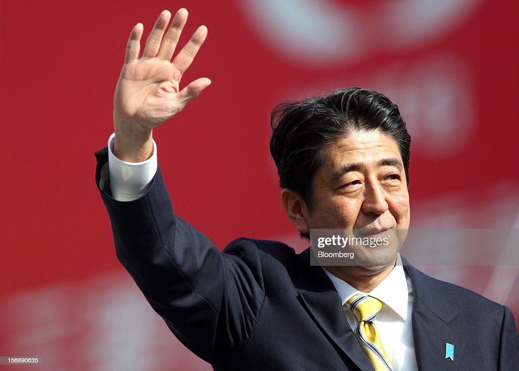 <a gi-track='captionPersonalityLinkClicked' href=/galleries/search?phrase=Shinzo+Abe&family=editorial&specificpeople=559017 ng-click='$event.stopPropagation()'>Shinzo Abe</a>, Japan's former prime minister and president of the Liberal Democratic Party (LDP), waves during a campaign rally for the Dec. 16 general election in Tokyo, Japan, on Saturday, Nov. 24, 2012. The government taking office after Japan's Dec. 16 election will pick the central bank's top three jobs, a chance to reshape policy in the third-largest economy that the opposition aims to seize for unlimited stimulus. Photographer: Tomohiro Ohsumi/Bloomberg via Getty Images