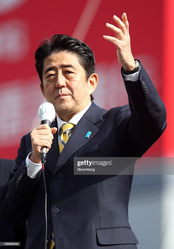 Shinzo Abe, Japan's former prime minister and president of the Liberal Democratic Party (LDP), speaks during a campaign rally for the Dec. 16 general election in Tokyo, Japan, on Saturday, Nov. 24, 2012. The government taking office after Japan's Dec. 16 election will pick the central bank's top three jobs, a chance to reshape policy in the third-largest economy that the opposition aims to seize for unlimited stimulus. Photographer: Tomohiro Ohsumi/Bloomberg via Getty Images