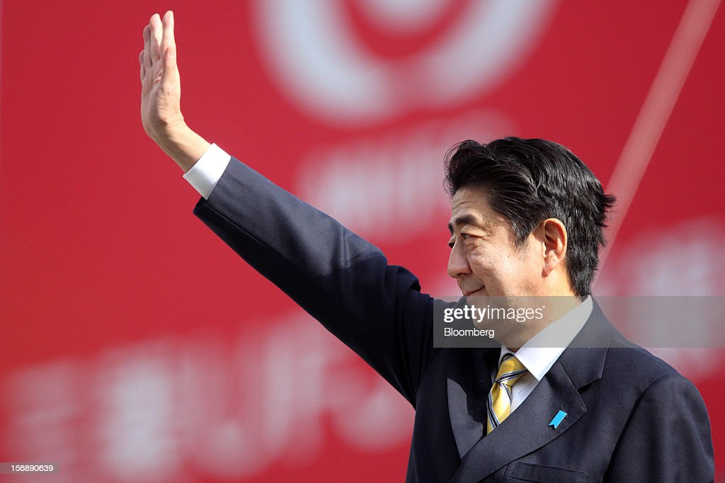 Shinzo Abe, Japan's former prime minister and president of the Liberal Democratic Party (LDP), waves during a campaign rally for the Dec. 16 general election in Tokyo, Japan, on Saturday, Nov. 24, 2012. The government taking office after Japan's Dec. 16 election will pick the central bank's top three jobs, a chance to reshape policy in the third-largest economy that the opposition aims to seize for unlimited stimulus. Photographer: Tomohiro Ohsumi/Bloomberg via Getty Images