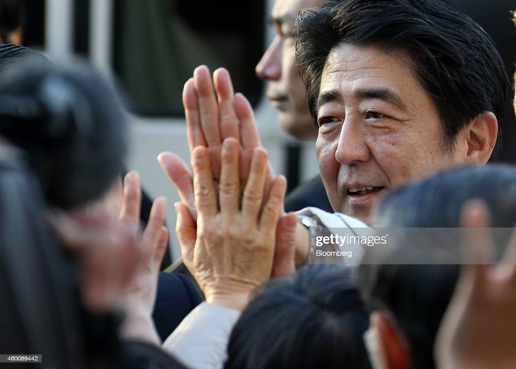 <a gi-track='captionPersonalityLinkClicked' href=/galleries/search?phrase=Shinzo+Abe&family=editorial&specificpeople=559017 ng-click='$event.stopPropagation()'>Shinzo Abe</a>, Japan's prime minister and president of the Liberal Democratic Party (LDP), gives high fives to supporters during an election campaign rally in Tokyo, Japan, on Sunday, Dec. 7, 2014. Abe has a rising chance of becoming Japan's longest-serving leader in more than four decades as the opposition is hobbled by factionalism and shifting policies as well as funding shortages. Photographer: Tomohiro Ohsumi/Bloomberg via Getty Images