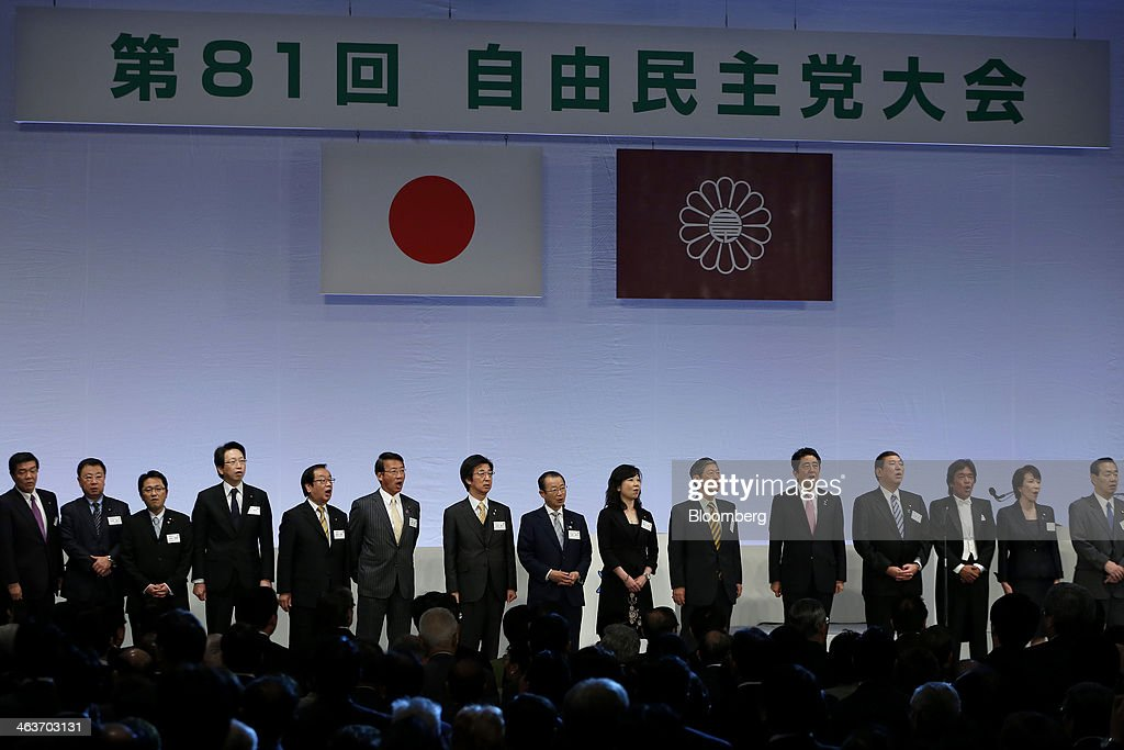 <a gi-track='captionPersonalityLinkClicked' href=/galleries/search?phrase=Shinzo+Abe&family=editorial&specificpeople=559017 ng-click='$event.stopPropagation()'>Shinzo Abe</a>, Japan's prime minister and president of the Liberal Democratic Party (LDP), fifth from right, sings the anthem of the Liberal Democratic Party (LDP) with other party members during the party's annual convention in Tokyo, Japan, on Sunday, Jan. 19, 2014. Abe will raise the consumption tax in April to 8 percent from 5 percent to help contain the nations swelling public debt. Photographer: Kiyoshi Ota/Bloomberg via Getty Images