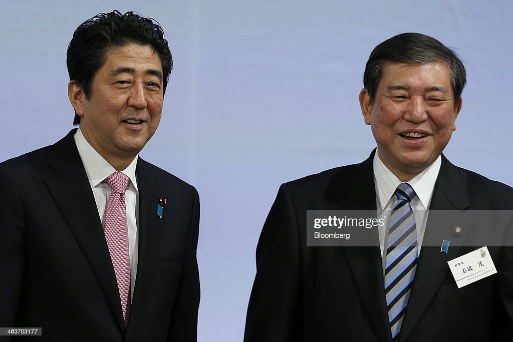 <a gi-track='captionPersonalityLinkClicked' href=/galleries/search?phrase=Shinzo+Abe&family=editorial&specificpeople=559017 ng-click='$event.stopPropagation()'>Shinzo Abe</a>, Japan's prime minister and president of the Liberal Democratic Party (LDP), left, and <a gi-track='captionPersonalityLinkClicked' href=/galleries/search?phrase=Shigeru+Ishiba&family=editorial&specificpeople=2921096 ng-click='$event.stopPropagation()'>Shigeru Ishiba</a>, secretary general, attend the Liberal Democratic Party's (LDP) annual convention in Tokyo, Japan, on Sunday, Jan. 19, 2014. Abe will raise the consumption tax in April to 8 percent from 5 percent to help contain the nations swelling public debt. Photographer: Kiyoshi Ota/Bloomberg via Getty Images