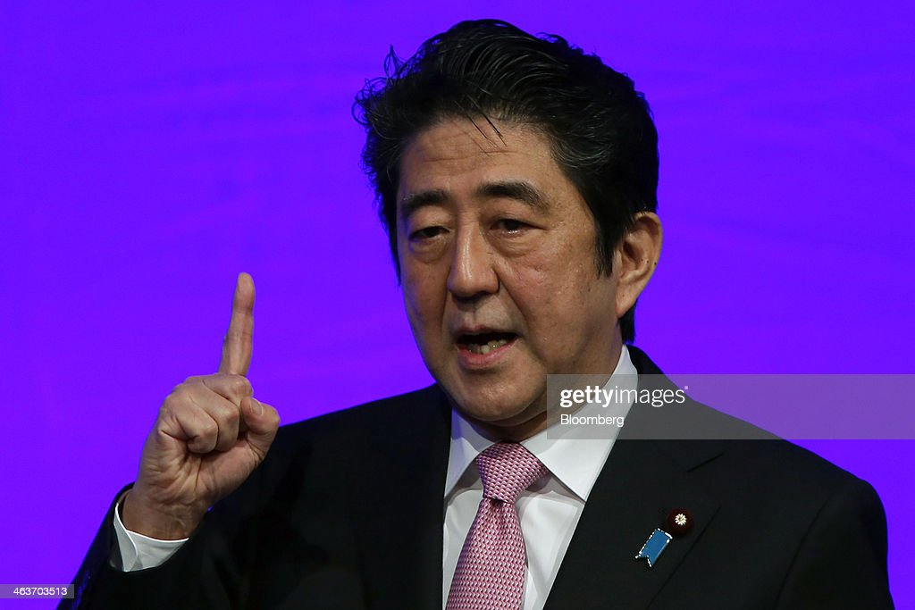 <a gi-track='captionPersonalityLinkClicked' href=/galleries/search?phrase=Shinzo+Abe&family=editorial&specificpeople=559017 ng-click='$event.stopPropagation()'>Shinzo Abe</a>, Japan's prime minister and president of the Liberal Democratic Party (LDP), gestures as he speaks during the Liberal Democratic Party's (LDP) annual convention in Tokyo, Japan, on Sunday, Jan. 19, 2014. Abe will raise the consumption tax in April to 8 percent from 5 percent to help contain the nations swelling public debt. Photographer: Kiyoshi Ota/Bloomberg via Getty Images