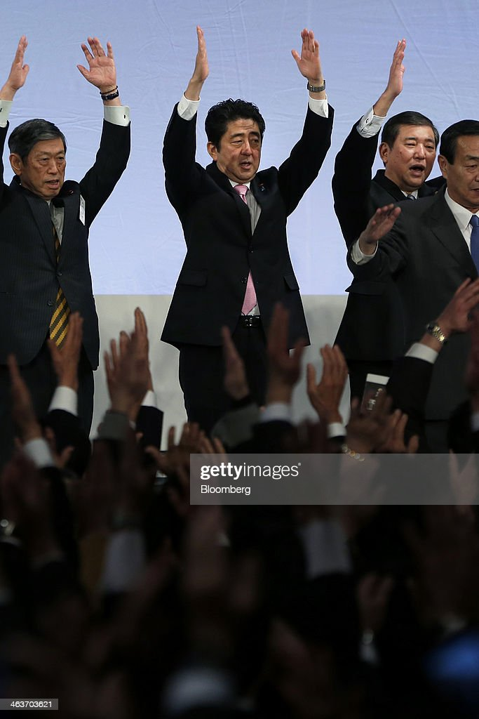 <a gi-track='captionPersonalityLinkClicked' href=/galleries/search?phrase=Shinzo+Abe&family=editorial&specificpeople=559017 ng-click='$event.stopPropagation()'>Shinzo Abe</a>, Japan's prime minister and president of the Liberal Democratic Party (LDP), center, cheers with <a gi-track='captionPersonalityLinkClicked' href=/galleries/search?phrase=Masahiko+Komura&family=editorial&specificpeople=2591868 ng-click='$event.stopPropagation()'>Masahiko Komura</a>, vice president, left, <a gi-track='captionPersonalityLinkClicked' href=/galleries/search?phrase=Shigeru+Ishiba&family=editorial&specificpeople=2921096 ng-click='$event.stopPropagation()'>Shigeru Ishiba</a>, secretary general, second right, and other party members during the Liberal Democratic Party's (LDP) annual convention in Tokyo, Japan, on Sunday, Jan. 19, 2014. Abe will raise the consumption tax in April to 8 percent from 5 percent to help contain the nations swelling public debt. Photographer: Kiyoshi Ota/Bloomberg via Getty Images