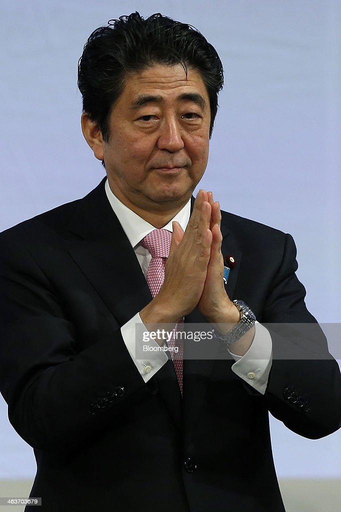 <a gi-track='captionPersonalityLinkClicked' href=/galleries/search?phrase=Shinzo+Abe&family=editorial&specificpeople=559017 ng-click='$event.stopPropagation()'>Shinzo Abe</a>, Japan's prime minister and president of the Liberal Democratic Party (LDP), claps his hands during the Liberal Democratic Party's (LDP) annual convention in Tokyo, Japan, on Sunday, Jan. 19, 2014. Abe will raise the consumption tax in April to 8 percent from 5 percent to help contain the nations swelling public debt. Photographer: Kiyoshi Ota/Bloomberg via Getty Images