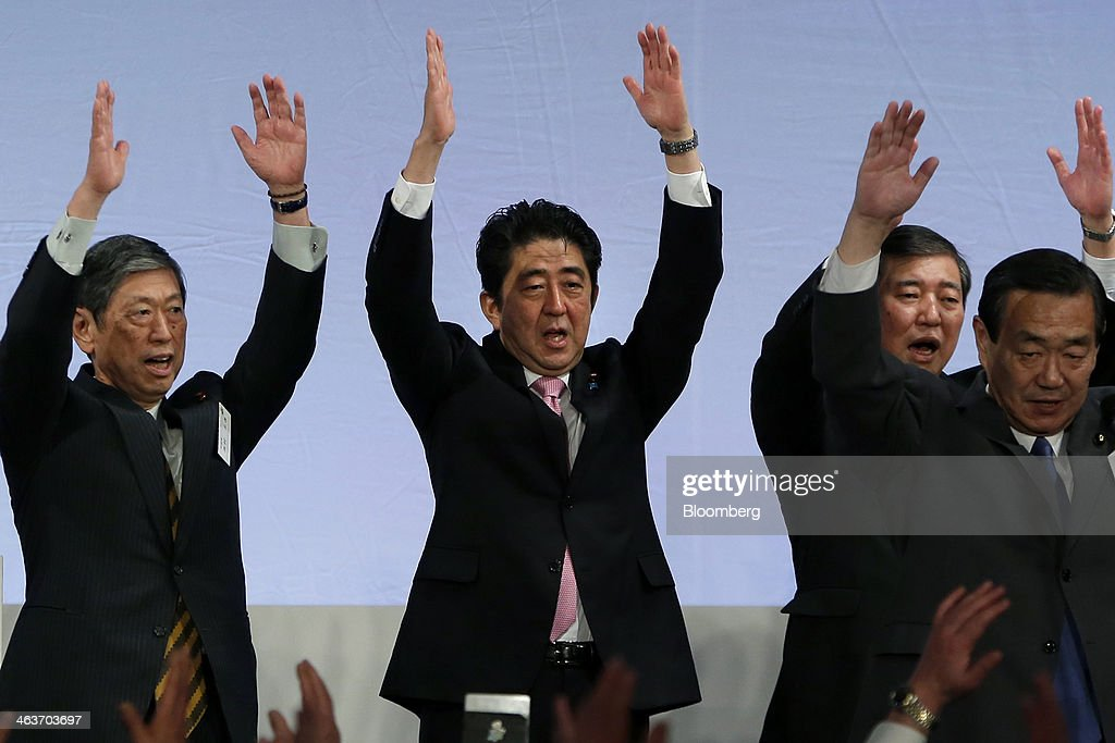 <a gi-track='captionPersonalityLinkClicked' href=/galleries/search?phrase=Shinzo+Abe&family=editorial&specificpeople=559017 ng-click='$event.stopPropagation()'>Shinzo Abe</a>, Japan's prime minister and president of the Liberal Democratic Party (LDP), center, cheers with <a gi-track='captionPersonalityLinkClicked' href=/galleries/search?phrase=Masahiko+Komura&family=editorial&specificpeople=2591868 ng-click='$event.stopPropagation()'>Masahiko Komura</a>, vice president, left, <a gi-track='captionPersonalityLinkClicked' href=/galleries/search?phrase=Shigeru+Ishiba&family=editorial&specificpeople=2921096 ng-click='$event.stopPropagation()'>Shigeru Ishiba</a>, secretary general, second from right, and other party members during the Liberal Democratic Party's (LDP) annual convention in Tokyo, Japan, on Sunday, Jan. 19, 2014. Abe will raise the consumption tax in April to 8 percent from 5 percent to help contain the nations swelling public debt. Photographer: Kiyoshi Ota/Bloomberg via Getty Images