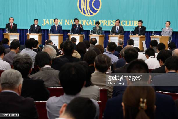 Shinzo Abe Japan's prime minister and president of the Liberal Democratic Party fourth left speaks as Tadatomo Yoshida president of the Social...