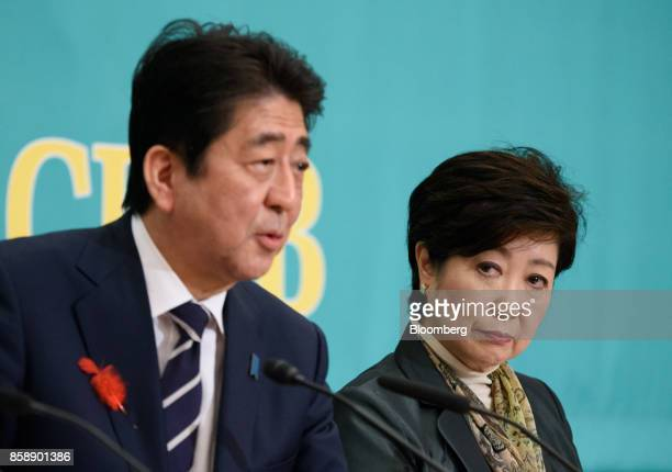Shinzo Abe Japan's prime minister and president of the Liberal Democratic Party left speaks as Yuriko Koike governor of Tokyo and head of the Party...