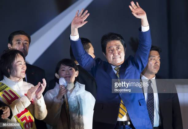 Shinzo Abe Japan's prime minister and president of the Liberal Democratic Party center right waves during an election campaign rally in Tokyo on...