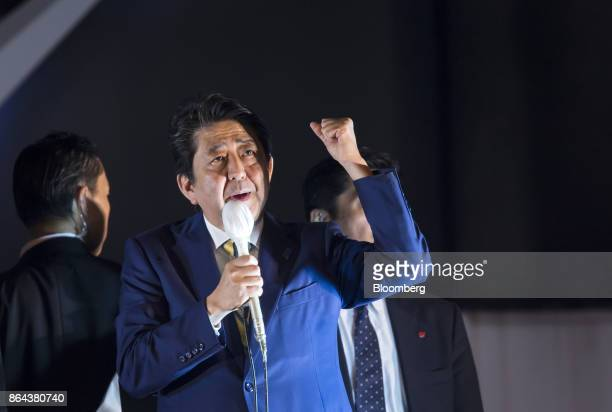 Shinzo Abe Japan's prime minister and president of the Liberal Democratic Party gestures as he speaks during an election campaign rally in Tokyo on...