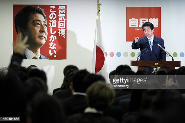 Shinzo Abe Japan's prime minister and president of the ruling Liberal Democratic Party points to a journalist as he takes questions during a news...