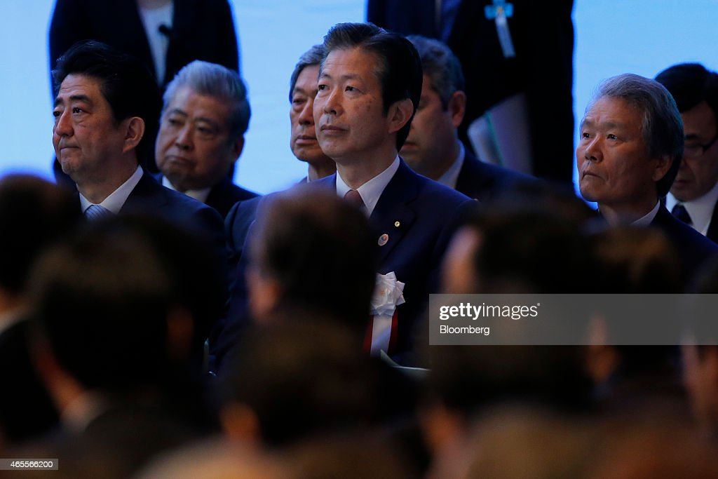 <a gi-track='captionPersonalityLinkClicked' href=/galleries/search?phrase=Shinzo+Abe&family=editorial&specificpeople=559017 ng-click='$event.stopPropagation()'>Shinzo Abe</a>, Japan's prime minister and president of the ruling Liberal Democratic Party (LDP), front left, <a gi-track='captionPersonalityLinkClicked' href=/galleries/search?phrase=Natsuo+Yamaguchi&family=editorial&specificpeople=5718603 ng-click='$event.stopPropagation()'>Natsuo Yamaguchi</a>, chief representative of the New Komeito Party, front center, and Sadayuki Sakakibara, chairman of Toray Industries Inc. and chairman of the business lobby Keidanren, front right, attend the Liberal Democratic Party's (LDP) annual convention in Tokyo, Japan, on Sunday, March 8, 2015. Abe said he will protect Japan's land, airspace and sea area. Photographer: Kiyoshi Ota/Bloomberg via Getty Images