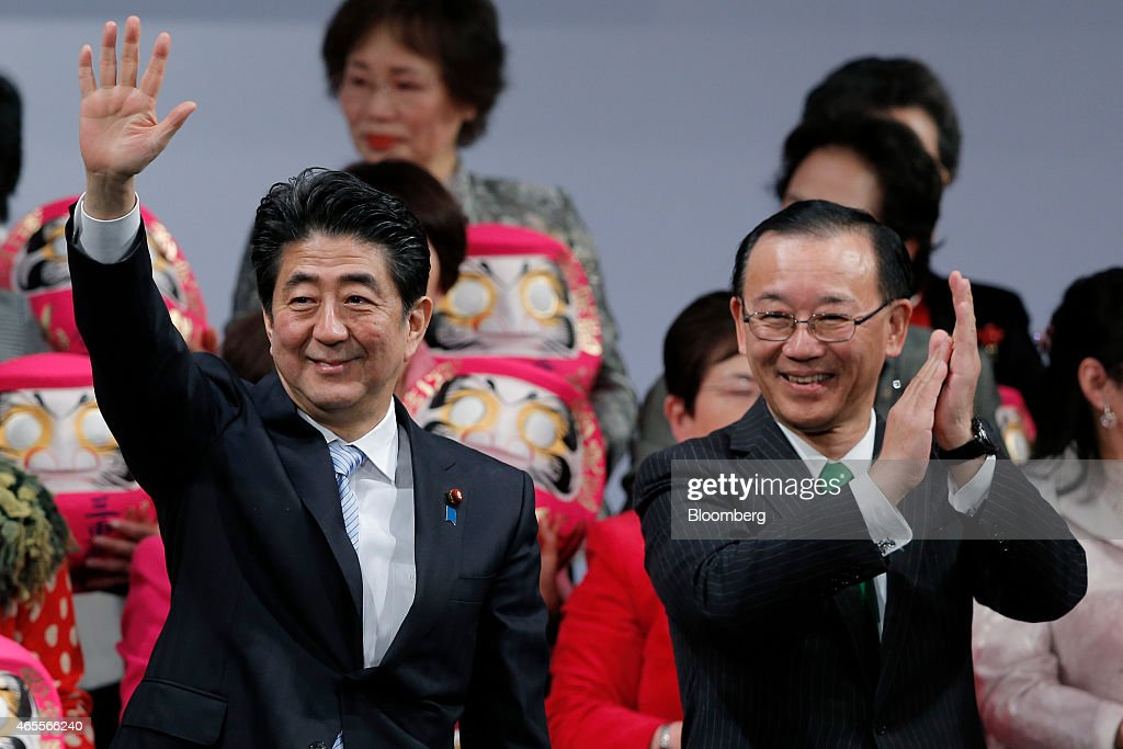<a gi-track='captionPersonalityLinkClicked' href=/galleries/search?phrase=Shinzo+Abe&family=editorial&specificpeople=559017 ng-click='$event.stopPropagation()'>Shinzo Abe</a>, Japan's prime minister and president of the ruling Liberal Democratic Party (LDP), left, waves as <a gi-track='captionPersonalityLinkClicked' href=/galleries/search?phrase=Sadakazu+Tanigaki&family=editorial&specificpeople=570027 ng-click='$event.stopPropagation()'>Sadakazu Tanigaki</a>, secretary general, applauds during the party's annual convention in Tokyo, Japan, on Sunday, March 8, 2015. Abe said he will protect Japan's land, airspace and sea area. Photographer: Kiyoshi Ota/Bloomberg via Getty Images