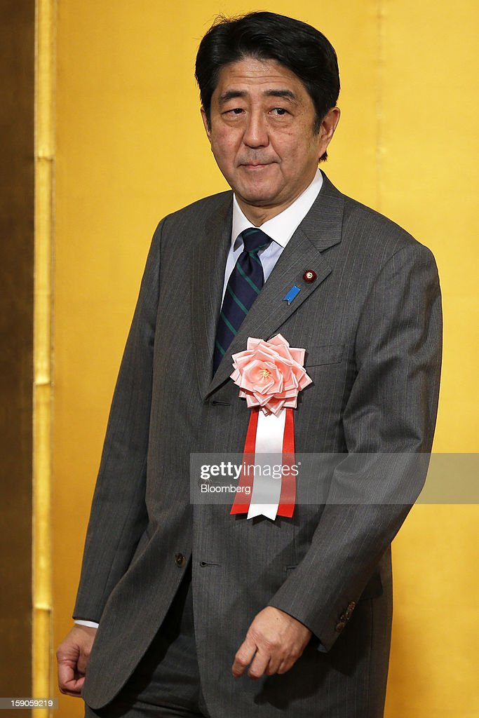<a gi-track='captionPersonalityLinkClicked' href=/galleries/search?phrase=Shinzo+Abe&family=editorial&specificpeople=559017 ng-click='$event.stopPropagation()'>Shinzo Abe</a>, Japan's prime minister, attends a New Year's party for business leaders in Tokyo, Japan, on Monday, Jan. 7, 2013. The Japanese government will announce around 12 trillion yen ($136 billion) in fiscal stimulus measures to boost the nation's shrinking economy, Japanese media reported today. Photographer: Kiyoshi Ota/Bloomberg via Getty Images