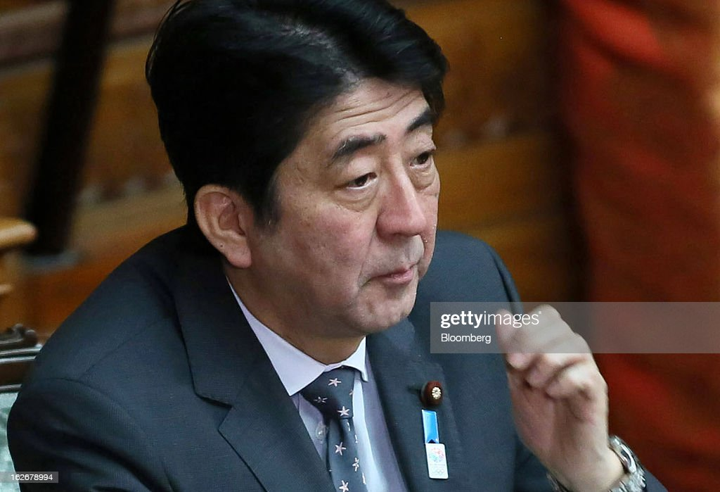 <a gi-track='captionPersonalityLinkClicked' href=/galleries/search?phrase=Shinzo+Abe&family=editorial&specificpeople=559017 ng-click='$event.stopPropagation()'>Shinzo Abe</a>, Japan's prime minister, attends a plenary session at the upper house of parliament in Tokyo, Japan, on Tuesday, Feb. 26, 2013. Abe's policies aimed at ending deflation could distort trade, drive up asset prices in other nations and lead to global financial instability, according to HSBC Holdings Plc. Photographer: Haruyoshi Yamaguchi/Bloomberg via Getty Images