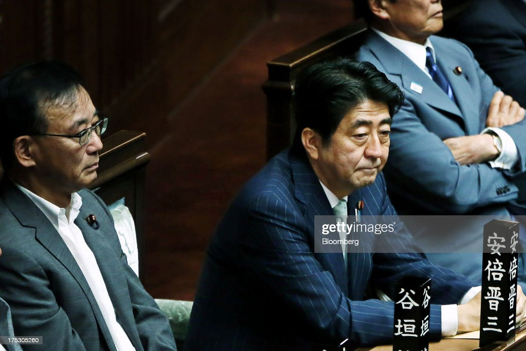 <a gi-track='captionPersonalityLinkClicked' href=/galleries/search?phrase=Shinzo+Abe&family=editorial&specificpeople=559017 ng-click='$event.stopPropagation()'>Shinzo Abe</a>, Japan's prime minister, center, and <a gi-track='captionPersonalityLinkClicked' href=/galleries/search?phrase=Sadakazu+Tanigaki&family=editorial&specificpeople=570027 ng-click='$event.stopPropagation()'>Sadakazu Tanigaki</a>, Japan's justice minister, left, attend a plenary session at the lower house of parliament in Tokyo, Japan, on Friday, Aug. 2, 2013. Abes economic stimulus policies have helped Japanese stocks become the best performers among major markets this year. Photographer: Haruyoshi Yamaguchi/Bloomberg via Getty Images