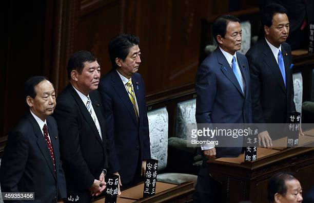 Shinzo Abe Japan's prime minister center Shigeru Ishiba minister in charge of regional economy second left Taro Aso deputy prime minister and finance...
