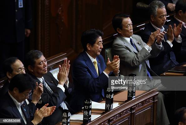 Shinzo Abe Japan's prime minister center Shigeru Ishiba minister in charge of regional economy third from left and Taro Aso deputy prime minister and...