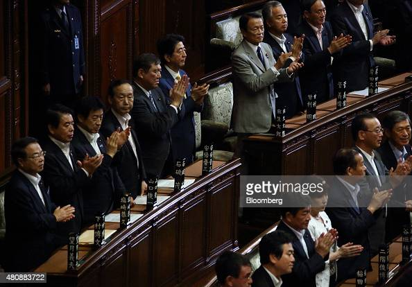 Shinzo Abe Japan's prime minister center Shigeru Ishiba minister in charge of regional economy fifth from left and Taro Aso deputy prime minister and...
