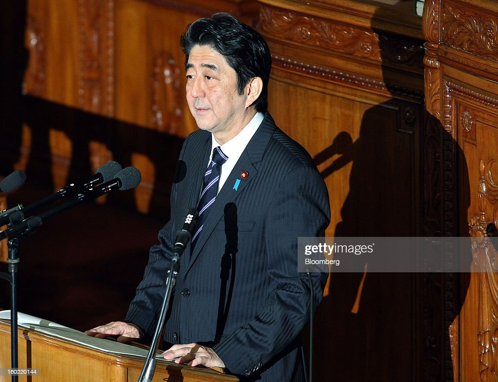 Shinzo Abe, Japan's prime minister, delivers his policy speech during the opening session of the Diet at the lower house of parliament in Tokyo, Japan, on Monday, Jan. 28, 2013. Abe's government predicts that tax revenue will exceed cash raised from bond sales for the first time in four years as the nation's economy emerges from last year's recession. Photographer: Haruyoshi Yamaguchi/Bloomberg via Getty Images