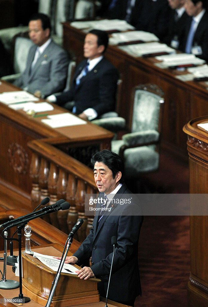 <a gi-track='captionPersonalityLinkClicked' href=/galleries/search?phrase=Shinzo+Abe&family=editorial&specificpeople=559017 ng-click='$event.stopPropagation()'>Shinzo Abe</a>, Japan's prime minister, delivers his policy speech during the opening session of the Diet at the lower house of parliament in Tokyo, Japan, on Monday, Jan. 28, 2013. Abe's government predicts that tax revenue will exceed cash raised from bond sales for the first time in four years as the nation's economy emerges from last year's recession. Photographer: Haruyoshi Yamaguchi/Bloomberg via Getty Images