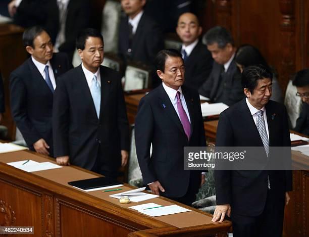 Shinzo Abe Japan's prime minister from right to left Taro Aso deputy prime minister and finance minister Akira Amari economic revitalization minister...