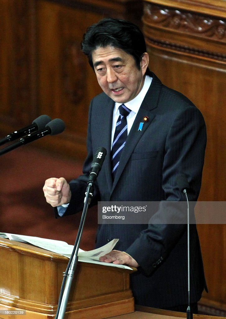 Shinzo Abe, Japan's prime minister, gestures as he delivers his policy speech during the opening session of the Diet at the lower house of parliament in Tokyo, Japan, on Monday, Jan. 28, 2013. Abe's government predicts that tax revenue will exceed cash raised from bond sales for the first time in four years as the nation's economy emerges from last year's recession. Photographer: Haruyoshi Yamaguchi/Bloomberg via Getty Images