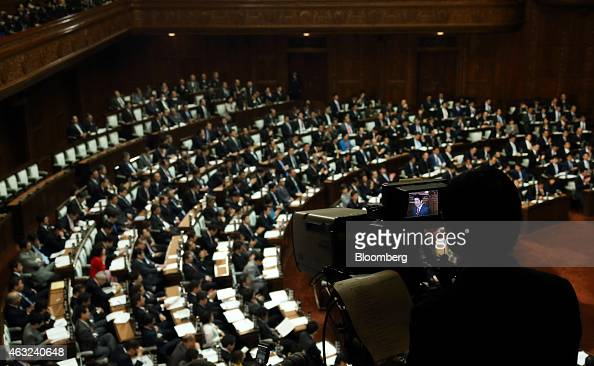 Shinzo Abe Japan's prime minister is seen on a television camera monitor while delivering his policy speech at the lower house of parliament in Tokyo...